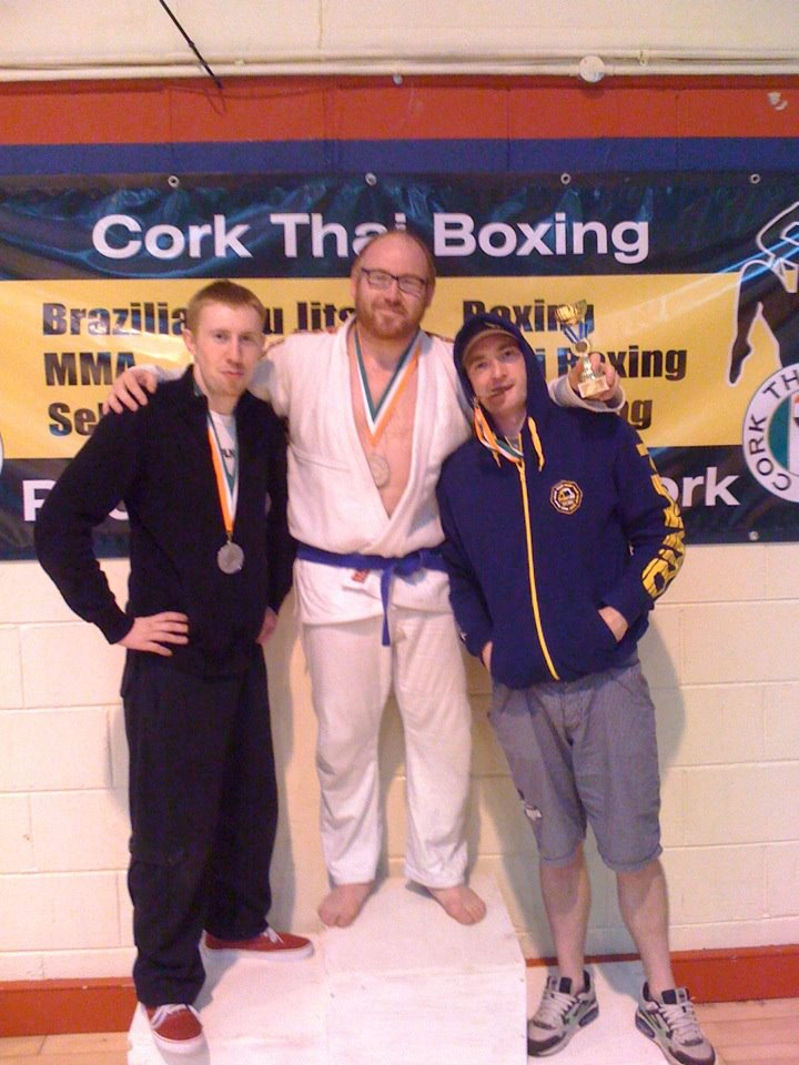 Grant, Tom, and Rowan with their medals. Aengus (not pictured) completed the representation from our club.