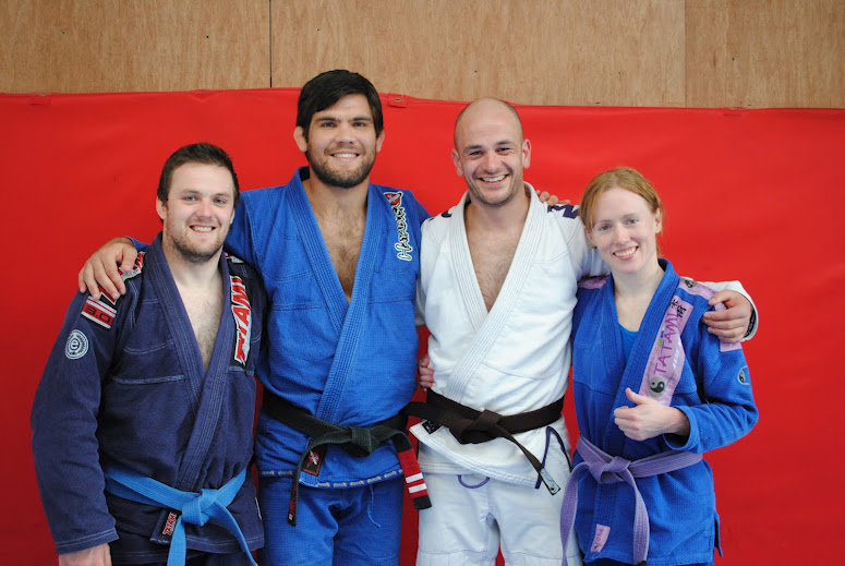 2012 Promotions From Left- Dave Reddy (Blue Belt), Robert Drysdale (Head Instructor), Barry Oglesby (coach and Brown Belt), Amanda English (Purple Belt)
