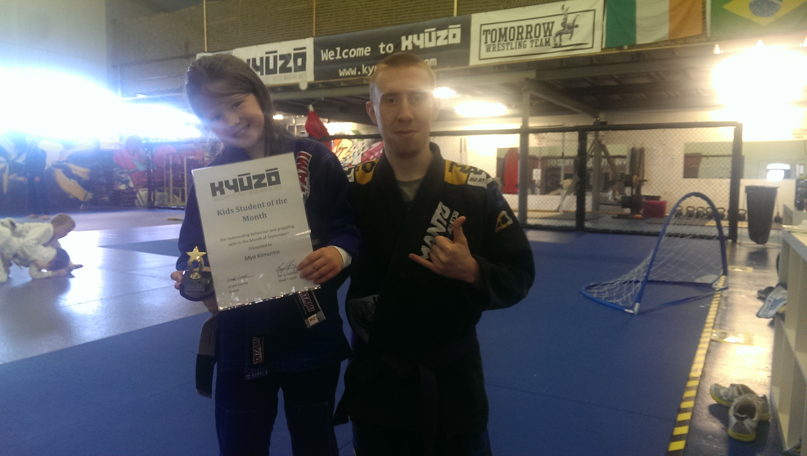 Mya receiving her Brazilian Jiu Jitsu Kids Student of the Month Award for September